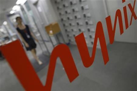 An employee of Hynix walks at the company's main office building in Seoul