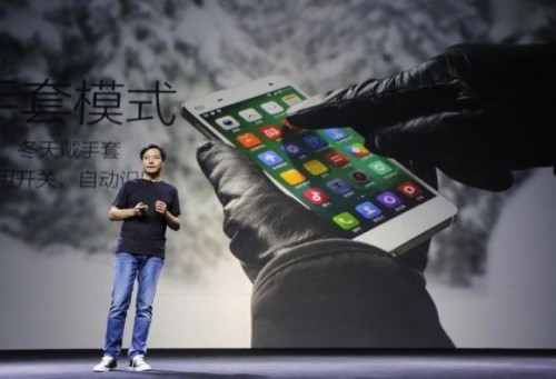 Lei Jun, founder and CEO of China's mobile company Xiaomi Inc, introduces the new features of Xiaomi Phone 4 at its launching ceremony, in Beijing
